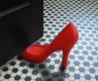 Foot in the door doorstop red